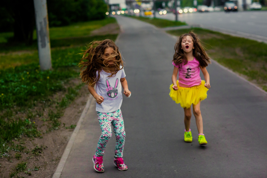 two little girls on the road